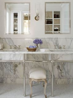 White 1920s Bathroom- marble makes it feel not so blaaahh, but still maintains the 1920's authenticity.