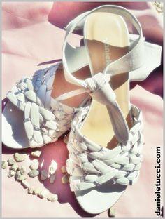 Sandalo #danieletucci  in vitello nappato bianco, intrecciato con laminato argento, zeppa in cuoio di 40 mm.   Collezione Primavera Estate 2014