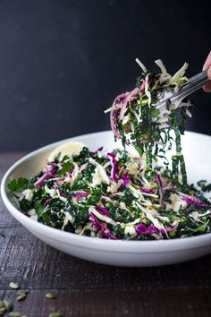 Everyday Kale Salad with simple Lemon Dressing can be made ahead then used DAILY to top off tacos wraps buddha bowls burgers and even pizza during the week! Vegan and Gluten Free this amazing kale slaw keeps for up to five days in the fridge. Meal P Kale Recipes, Gourmet Recipes, Whole Food Recipes, Vegan Recipes, Cooking Recipes, Cooking Ham, Recipies, Kale Slaw, Snacks