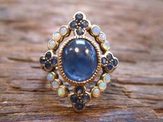 Opal  sapphire antique ring  ....this is interestingly close to MY engagement ring....that doesn't exist yet...