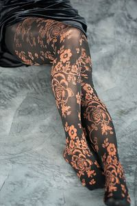 Silky soft and fantastically floral... black tights with bronze vines & flowers twisting artistically around your legs.