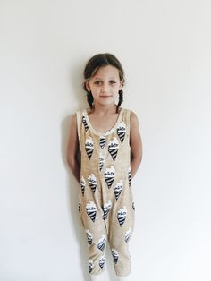 Chocolate tank top playsuit with gelato allover print. Round neckline and half front opening with snaps. 100% organic cotton terry