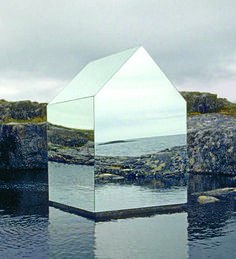 "An uninhabitable structure built on Scotland's Isle of Tyree by the artist Ekkehard Altenburger, this small mirrored house appears to float, nearly camouflaged by the surrounding landscape. ""The idea of these houses is to create a literal reflection of the environment around them,"" notes Roke."