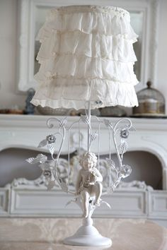 I love this lamp. Maybe with out the angel and scroll things. ok so maybe I just love the lamp shade.