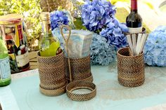 Convenient woven flatware/bottle holder with detachable compartments, by Calaisio. Great for outdoor serving needs!