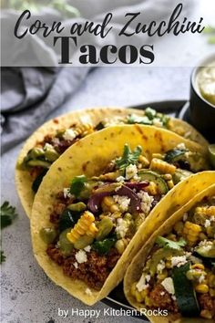 The best zucchini tacos recipe ever, made of grilled corn and zucchini, tempeh taco meat and black beans merged together with creamy avocado dressing. #tacos #vegetariantacos #tacorecipe #tacotuesday #summerrecipe #zucchini #feta #corn #avocado #bbq #grilledcorn #vegetarianrecipe #vegetarianmain #vegetariandinner | happykitchen.rocks