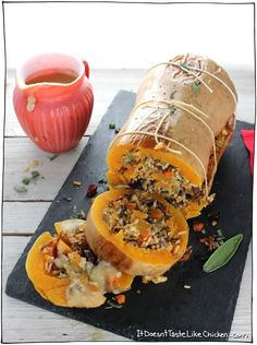 Stuffed Roasted Butternut Squash! The perfect vegan centrepiece main dish for Thanksgiving, Christmas, or any holiday. Stuffed with super flavourful wild rice, cranberries, walnuts, and sage filling. Can be made up to 3 days ahead of time and warmed up before serving. Gluten-free, vegan, vegetarian, dairy-free. #itdoesnttastelikechicken #veganrecipes #thanksgiving