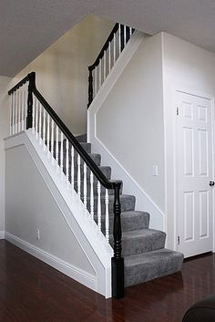 Lampert Daggett I think I am going to paint mine black, just railing a. Lampert Daggett I think I am going to paint mine black, just railing and banisters. here is a pic with carpeted stairs like yours. Black Stair Railing, Stair Banister, Black Stairs, White Staircase, Banisters, Wood Stairs, White Banister, Banister Ideas, Black Painted Stairs