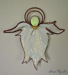 Glass Angel with a unique design, the body & wings are white iridescent fused glass with a dichroic glass head and assembled with copper foil.