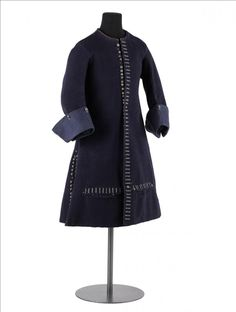 Around 1660-1675 Coat - blue wool, lining of blue wool twill, wooden buttons covered with blue silk trim.