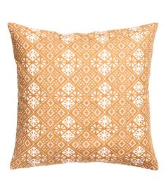 Mustard yellow. Cushion cover in cotton twill with a printed pattern. Concealed zip.