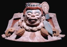 Ceramic cacao vessel lid from Tonina, cacao beans guarded by monkey (Photo in public domain)