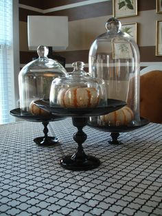 Brass candlesticks sprayed glossy black topped with black plates from Dollar Tree. YES!