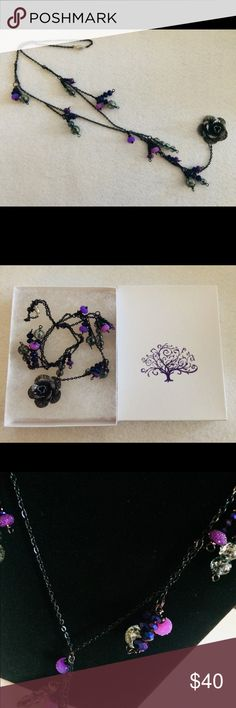 Flower and beaded charm necklace. Elegant and one of a kind! Low-hanging, purple, black, and glass beaded chain necklace with flower charm. Jewelry Necklaces
