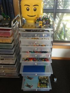 40 Awesome Lego Storage Ideas in this post: most are too extensive, but I like this vertical shelving idea.