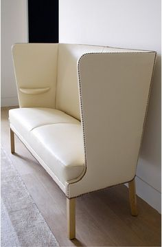 by pierre yovanovich Not only do I adore the glam factor of this settee (nailheads on creamy leather? yes please.) but the teeny shelf just large enough to perch your champagne glass on? Genius. Related
