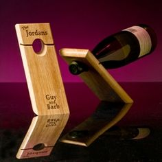 custom engraved wood wine bottle stand.  design yours at www.TheTipsyGrape.com