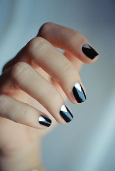 A black-and-silver manicure.