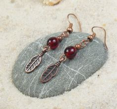 feather dangle copper earrings by MySoulCanDance