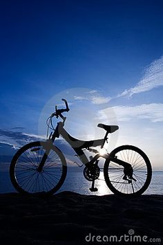 A Bike on the Beach by Jeeragone Inrut, via Dreamstime