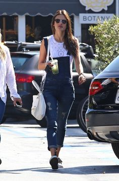 Alessandra Ambrosio pairs her Black Orchid denim overalls with a white eyelet top and sneakers | @andwhatelse