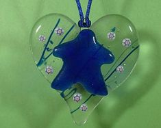 Unique glass art by LeavesOfGlassArt on Etsy Fused Glass Ornament: Cast Meeple and millis tack-fused to a heart-shaped base ornament Fused Glass Ornaments, Stained Glass Art, Suncatchers, Tack, Heart Shapes, Art Projects, Etsy Seller, Leaves, Christmas Ornaments