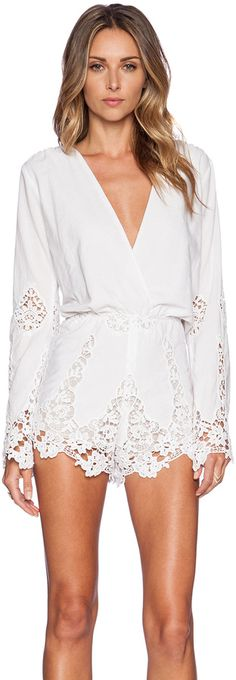 love this deep v white lace romper