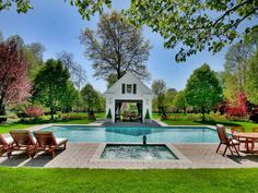 Lounge in the sun or move into the shade — this stately patio offers the best of the outdoors. Manicured landscaping and a lush lawn offsets a Hamptons-style swimming pool and accompanying hot tub.