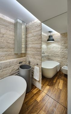 Stone mirror and wood bathroom