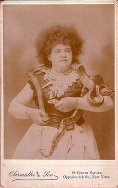 33 Amazing Vintage Photos of Female Circus Snake Charmers From the Early 20th Century