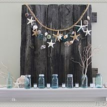 Summer Mantel with shells, starfish and mason jars.