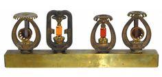 Salesman's sample fire sprinkler head display, marked Grinnell Spray Sprinkler, 4 unique brass models on brass block