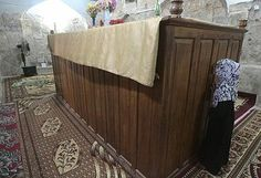 Muslim woman praying near Ezekiel's tomb, located in Al Kifl, Iraq, is believed by Jews to be the tomb of the biblical prophet Ezekiel.   Iraqi Jewry was once one of the largest and most prominent Jewish communities in the Middle East. Until the mid-20th century, up to 5,000 Jews used to come to the tomb during Passover.  An additional structure also identified as a possible tomb for Ezekiel can be found in Dezful, Iran.