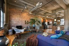 About as good as it gets...love the exposed ceiling, duct work, pipes, brick. Looks so comfortable and liveable.