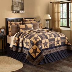Teton Star quilt and bedding by VHC Brands proudly displaying traditional 8-point stars alternating with patchwork blocks in navy blue and tan finished with triple borders. Reverses to solid navy blue.