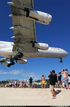 Air France A340-313X landing at St. Maarten Princess Juliana. View from Maho Beach