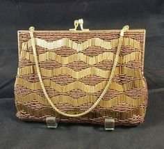 Check out this item in my Etsy shop https://www.etsy.com/listing/243279706/bronze-beaded-evening-bag-signed-walborg