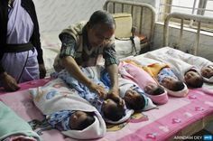 INDIA, Agartala : An Indian health official administers polio drops to newborn babies during Polio Day at a government hospital in Agartala, the capital of the northeastern state of Tripura, on January 18, 2015. Some 174 million children aged below five years across the country will be given polio drops as part of a government drive to maintian India's 'polio-free' status, a Health Ministry statement said. AFP PHOTO / ARINDAM DEY