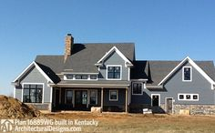 Back view of Architectural Designs House Plan 16889WG client-built in Kentucky. The plan gives you 3 to 4 beds, 3 baths and over 2,400 square feet of living. Ready when you are. Where do YOU want to build?