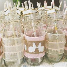 Some bunny is turning one. First birthday. Bunny themed party. Shabby chic. Glass milk jugs. Little girl birthday party.