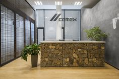 Built by Atelier Povetron in Prague, Czech Republic The main task was to design the interior office space for the company CEMEX, which is engaged inmanufacturing of conc. Office Reception Design, Modern Reception Desk, Reception Counter, Office Interior Design, Office Interiors, Commercial Architecture, Interior Architecture, Workplace Design, Healthcare Design