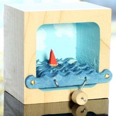 Kinetic Sailboat Scultpure, with Blue Sky and Clouds. $38.00, via Etsy.