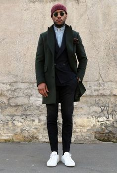 Go for a classic style in a hunter green overcoat and black suit pants. White low top sneakers will add some edge to an otherwise classic look.   Shop this look on Lookastic: https://lookastic.com/men/looks/overcoat-double-breasted-blazer-long-sleeve-shirt/17951   — Burgundy Beanie  — Light Blue Chambray Long Sleeve Shirt  — Black Double Breasted Blazer  — White Low Top Sneakers  — Black Dress Pants  — Dark Brown Leather Watch  — Dark Green Overcoat  — Dark Brown Leather Gloves