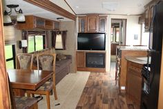 2014 Wildwood Lodge 404FB by Forest River (Stock Num 8335) A lucky find with this 3 slide-out, 2014 Wildwood Lodge Park model. You will fall in love with this family cottage which can be delivered to your destination! - See more at: http://www.earltonrv.com/rv/pre-owned/park-model/8335#sthash.AyziAStc.dpuf