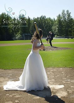 groom throwing baseball at baseball theme wedding in alaska