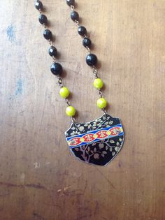 Black shield vintage tin beaded necklace on Etsy, $34.00