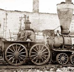 Destroyed 4-4-0 locomotive and roundhouse probably Atlanta, Georgia 1864