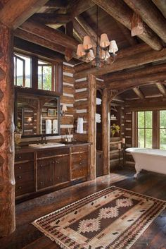 "This reminds me of r house. I LOVE this Rustic bathroom! Nice for a ranch home/hunting lodge. ""Beautiful and rustic log home bathroom with an abundance of warm-toned wood"" Log Cabin Living, Log Cabin Homes, Log Cabins, Mountain Cabins, Big Mountain, Mountain Park, Rustic Bathroom Designs, Rustic Bathrooms, Bathroom Ideas"