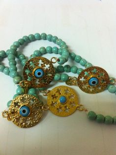 Turquoise and gold plated bracelets supporting kids with cancer.    lumani designs