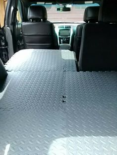 Easy way to dog proof your SUV. We got those puzzle piece exercise mats at the five below store and cut them to fit the back of the car. Weather tech did not make a mat that went behind the driver and passenger seats only the second row so we made our own. Much cheaper.